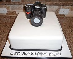 cannon with pics all around the cake would be perfect