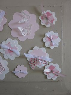 Sale: Paper flower wall art with a couple cute little butterflies in light creme and pink  --- Use them as wall art or as party decor. €9.95, via Etsy.