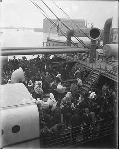 Immigrants at Locust Point, deck of ship in harbor.