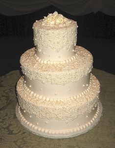 Wow! Add a couple little sparkles on this and it's be ama-zing! Ivory Pearl Wedding Cake by Beautiful Cakes