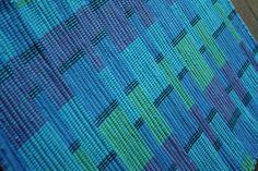 Bright turquoise rag rug by TwoCedarsWeaving on Etsy, $30.00