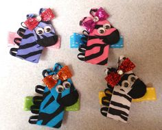 """Zebra ribbon hair clips! 2 for $6 + shipping, can mix n match if heart desires =) ...contact me through FB """"Skullkandy Bowtique Nmore"""" or email me at lauraburkett34@gmail.com"""