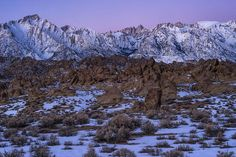 Alabama Hills, Owens Valley, California    I love to watch the fine mist of the night come on, The windows and the stars illumined, one by one,  The rivers of dark smoke pour upward lazily, And the moon rise and turn them silver. I shall see The springs, the summers, and the autumns slowly pass; And when old Winter puts his blank face to the glass, I shall close all my shutters, pull the curtains tight, And build me stately palaces by candlelight.    ~ William O. Douglas