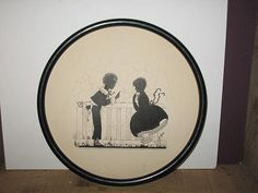 Precious silhouette of boy & girl in unusual round shape.  Love all the detail in this one.