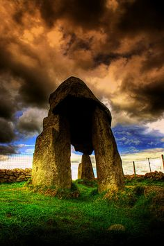 Legananny Dolmen  This ancient burial site is located on the southern fringe of the Slieve Croob mountain range in Co Down in Ireland. The structure consists of two portal stones to the south, one 5ft 9ins high, the other 6ft and a further single support at the north end, 4ft high. The long capstone, almost 2ft in diameter gives the structure its distinctive tripod appearance.