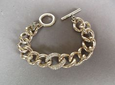 Victoria Secrets gold tone curb link chain bracelet with rhinestone link  #VictoriasSecret #Chain