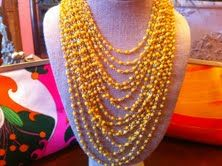 $120  Fabulous multi strand glass bead necklace with 18k gold plated clasp!! Gorgeous yellow for the spring!!