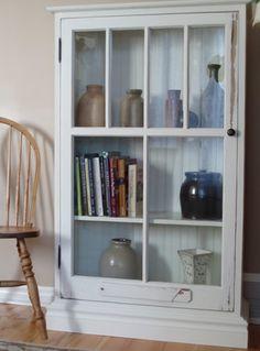 Old window repurposed into a cabinet door