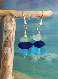 Beautiful !! Tropical Aqua and blue beach glass wire wrapped earrings. These Bohemian style beach earrings measure just under 1 1/4 inch including the Sterling silver .925 earring wires. I have added a bit of sparkle to mimic the sea with Swarovski crystals. ~ We have many beach inspired items~ Sea Glass Jewelry, Island Jewelry, Florida Island Jewelry, Sea Glass Earrings, Seaglass, Beach Glass Earrings, Beach Jewelry, gifts from Florida Wedding Jewelry, Green Sea Glass, Handmade in Sunny…