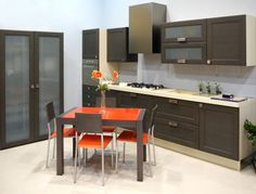 Cool Contemporary Cabinetry  A frosted glass pantry offers a sneak peak of what's for dinner and a perfect contrast to the dark cabinets.