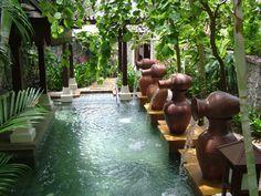 Garden Pool- love the jar fountain aspect!