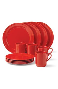 Adding a splash of vibrant color to the kitchen with this bright red dish set by Kate Spade. These fun place settings can go from retro to festive by adding accent pieces.