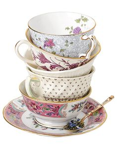 My next tattoo is going to be a stack of teacups, like this, on my inner calve. But no filler, just blue lines.