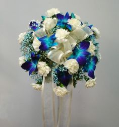 Google Image Result for http://secure3.websystems.com/valleyflorist/images/orchid-_carns_bouquet.jpg