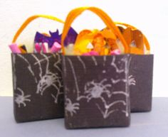 Handmade miniature Halloween bags filled with goodies!  www.colnedollhouseshop.co.uk