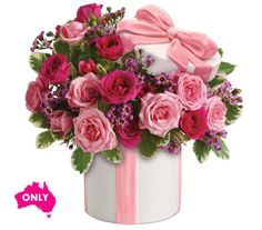 """Buy """"Hats Off To Mum"""" for $104.95. Think Outside And Inside The Box And You Will Choose This Adorable Gift For Mum. Delightful Pink Roses And Spray Roses Delivered In A Ceramic Hat Box With A Sculpted Pink Ribbon. The Hat's Off Keepsake Vase Is 10cm High And 11.5cm Wide. The Hats Off Keepsake Vase Is Only Available For Delivery In Australia. Flowers Are Subject To Seasonal Availability. In The Event That Any Of The Flowers Are Unavailable, The Florist Will Substitute With A Similar Flower In…"""