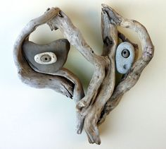 """Look Into the Face of Love"" Driftwood Art by Mother Nature. Handmade by Doctor Driftwood. Made out of ""all natural"" handpicked driftwood and stones ""reclaimed"" from California. ""Where Nature and Style Meet."" Follow me at Facebook/DoctorDriftwood and Pinterest/DoctorDriftwood. Look for me on Flickr/DoctorDriftwood. Visit DoctorDriftwood.com for sales, more info, and harmony. Enjoy Nature in your home. Cheers!"