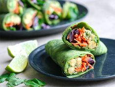 Spinach wraps filled with avocado and chickpea hummus, fresh veggies and lots of cilantro! - by Maikin mokomin #vegan