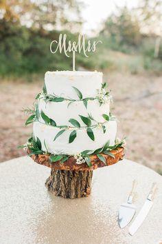 Beautiful woodland wedding cake with greenery
