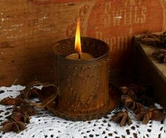 Primitive Crafts hot glue on tin can then paint over