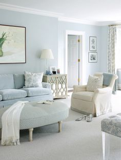 Living room with soft blues, greens and white.