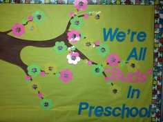 "A cute bulletin board for spring!!!  We took pictures of each student and placed them in the center of a bud on a tree.  We're all ""buds"" in preschool!!!"