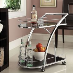 The beautiful, X-design chrome metal bar cart makes it easy to serve guests in style. This cart features black tempered glass on the top and bottom shelves, and caster wheels that make it easy to transport and entertain your guests.
