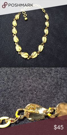 Vintage Coro 40s to 50s gold tone & enamel choker Vintage Coro choker necklace from the 1940s to early 1950s. Enamel over goldtone base in a linked yellow leaf figural design. Measures 11 inches with 5 in extension. Hallmark says Coro patent pending Coro Jewelry Necklaces