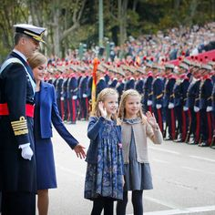 Letizia and Felipe proudly looked on as their daughters waved to well-wishers during Spain's 2015 National Day celebrations. <br>Photo: © PA