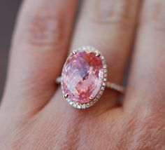 This is some major bling!  Padparadscha Sapphire Ring 14k Rose Gold Diamond 10.3ct Oval Peach Sapphire Engagement Ring by EidelPrecious on Etsy