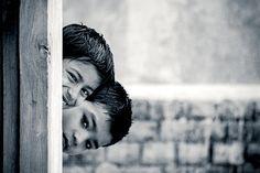 Monochrome portrait of child playing Hide & Seek.