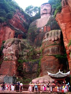 Leshan Giant Buddha - a 233-foot tall stone statue built during the Tang Dynasty - is carved out of a cliff face at the confluence of the Minjiang, Dadu and Qingyi rivers in southern Sichuan province in China, near the city of Leshan. The stone sculpture faces Mount Emei, with the rivers flowing below his feet. It is the largest stone Buddha, and it is by far the tallest pre-modern statue in the world. Click on this image and on the next two images to see the details real up-close.