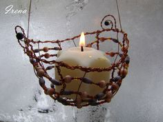 A bead-wire hanging candle holder
