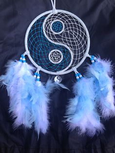 """7"""" white and blue yin yang dream catcher with glow in the dark web. Available on eBay"""