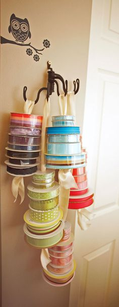 A beautiful way to display your ribbon by using a towel rack, ribbon folded in half & knotted on one end, then thread your spools of ribbon through them and hang.