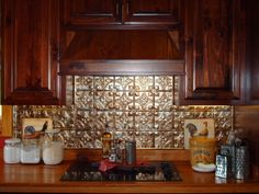 "punched tin backsplash behind stove kitchen | Fan of ""french country, primitive, rustic, farmhouse....Oh heck...I ..."