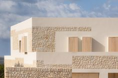 Nomo Studio clads Stone House in Menorca with limestone from its site – Pavement İdeas Limestone House, Limestone Wall, Stone Facade, Wooden Shutters, Ground Floor Plan, House Elevation, Stone Houses, Winter Garden, Contemporary Architecture