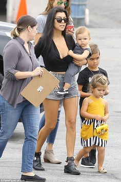Family first: Kourtney Kardashian was spotted arriving with her three children ata children's birthday party for Tyga's son King Cairo Stevenson at Racer's Edge in Burbank, California on Friday afternoon
