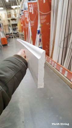 Don't hire a contractor to install baseboard. This step-by-step guide contains everything you want and need to know about how to install baseboard yourself. Home Improvement Projects, Home Projects, Wood Baseboard, Baseboard Ideas, Moldings And Trim, Crown Molding, Moulding, Door Molding, How To Install Baseboards