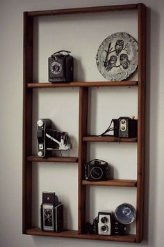 Shelf Display With Vintage Cameras Perfect For A Studio