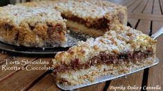 La Torta Sbriciolata Ricotta e Cioccolato è un dolce golosissimo sia per i grandi che per i più piccini. Si prepara più facilmente rispetto alla crostata