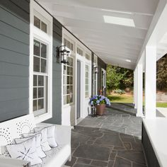 Cape Cod style waterfront estate in Vancouver by Jodi Foster Design Trim Moulding Exterior Porch Tile, Porch Flooring, Porch Roof, Stone Flooring, Vancouver, Bungalow, Porches, Traditional Porch, Haus Am See