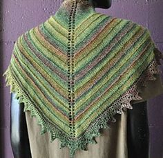 The shawl features eyelets and center decreasing to form the triangle. The beautiful peaked lace border is worked last from the bottom edge. This is a good project for learning mitered decreasing and eyelet decoration, and it looks fabulous, too.