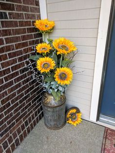My entryway. Antique Milk jug and sunflowers
