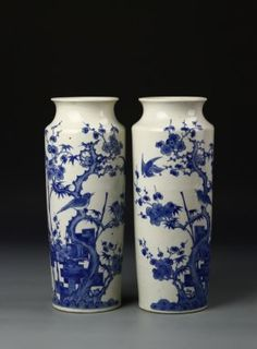 China, 19th C. a pair of blue and white Vases, with Guangxu mark. Height 12 in.