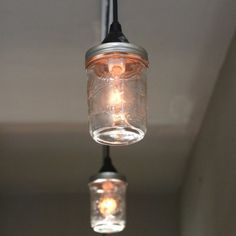 Learn how to make mason jar pendant lights compatible with a track light system for an industrial modern lighting update.