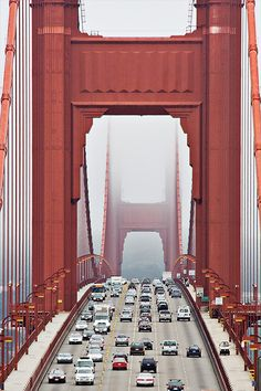 Classic view of traffic on the Golden Gate Bridge. How many lamps are there? (Bored commuters may have counted.)