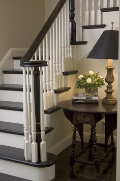 Love the classic decor on these painted stairs. Painting wooden stairs in such a traditional palette really looks great in this stairway. Wood Staircase, Stair Railing, Staircase Design, Banisters, Black Banister, Stairs With White Risers, Railings, Black And White Stairs, Black Staircase