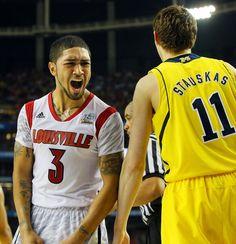 040813 ATLANTA: Louisville guard Peyton Siva reacts to defeating Michigan to win the NCAA Division I National Championship on Monday, April 8, 2013, in Atlanta. CURTIS COMPTON/ CCOMPTON@AJC.COM
