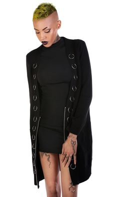 Chunky rib longline cardigan with metal hardware. Oversized fit. Cotton / Acrylic blend. Model is 6' and is wearing size Small. TAG YOUR PURCHASE: #disturbiaclothing IN STOCK & SHIPS WITHIN 24 HOURS